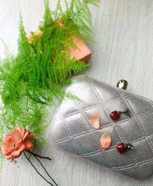 A clutch purse and flower and leaves