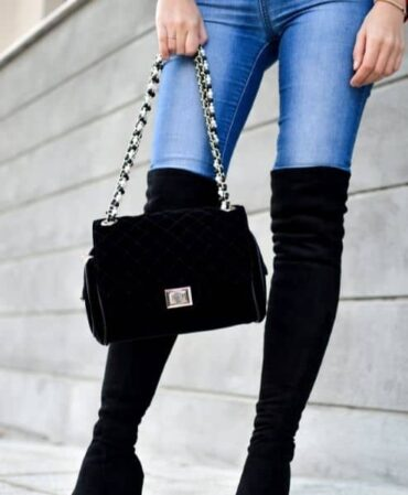 A lady's legs with boot and bag