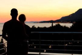 A couple facing the sunset