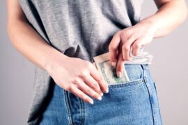 A person pocketing the money